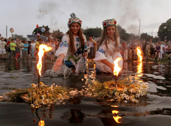 Belarusian girls float wreaths with candles as part of the Ivan Kupala festival.